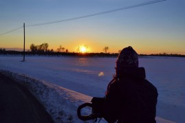 Silvia looking at a sunset of a very snowy February